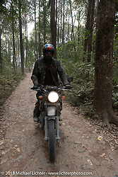 Round the World Doug Wothke riding out through the forest from the Kusma Gyadi Bridge on Day-7 of our Himalayan Heroes adventure riding from Tatopani to Pokhara, Nepal. Monday, November 12, 2018. Photography ©2018 Michael Lichter.