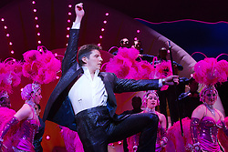 "© Licensed to London News Pictures. 21 March 2014. London, England. Pictured: Nigel Harman as Simon. Photocall for the Simon Cowell X-Factor Musical ""I Can't Sing!"" written by Harry Hill and Steve Brown at the London Palladium. Directed by Sean Foley with Nigel Harman as Simon, Victoria Elliott as Jordy and Ashley Knight as Louis. Photo credit: Bettina Strenske/LNP"