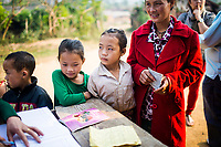 A family at the JE vaccination campaign in Khon Kahndone Village, Xieng Khouang province, Laos.