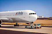 A Delta Air Lines Boeing 767-332ER being towed at Hartsfield-Jackson Atlanta International Airport.  March, 2010.