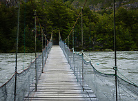 NATIONAL PARK TORRES DEL PAINE, CHILE - CIRCA FEBRUARY 2019: Footbridge over the River Pingo in Torres del Paine National Park, Chile.