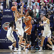 UNCASVILLE, CONNECTICUT- DECEMBER 4: Brianna Taylor #20 of the Texas Longhorns passes the ball while defended by Natalie Butler #51 of the Connecticut Huskies during the UConn Huskies Vs Texas Longhorns, NCAA Women's Basketball game in the Jimmy V Classic on December 4th, 2016 at the Mohegan Sun Arena, Uncasville, Connecticut. (Photo by Tim Clayton/Corbis via Getty Images)