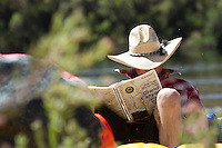 Man reading guide for rafting the Grand Canyon. Grand Canyon National Park, AZ.