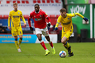 AFC Wimbledon defender Steve Seddon (42) dribbling during the EFL Sky Bet League 1 match between Charlton Athletic and AFC Wimbledon at The Valley, London, England on 12 December 2020.
