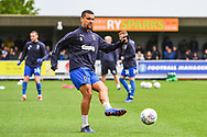 AFC Wimbledon Defender Deji Oshilaja (4) warms-up ahead of the EFL Sky Bet League 1 match between AFC Wimbledon and Wycombe Wanderers at the Cherry Red Records Stadium, Kingston, England on 27 April 2019.