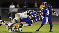 Plainville quarterback Jeff Ziegenhagen is hit by Platt's Cyrick Watford during a game between Plainville and Platt.