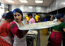 WATFORD HERTFORDSHIRE: A young girl prepares puris in the volunteer kitchens. Over 55,000 pilgrims and guests visit the Largest Hindu Festival in Europe at Bhaktivedanta Manor Krishna Temple near Watford on Sunday 5th September to celebrate Janmashtami the birth of Lord Krishna. The Manor was donated to the Hare Krishna Movement in the early 1970s by former Beatle George Harrison. 03 SEPT 2010. STEPHEN SIMPSON ..