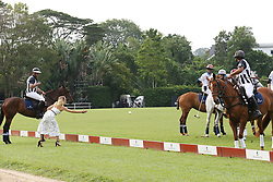 Joanne Froggatt throws a ball as Prince Harry (not pictured) takes part in the Sentebale Royal Salute Polo Cup at the Singapore Polo Club.