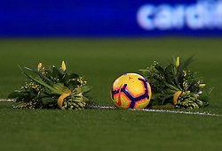 Flowers placed on the pitch ahead of the match in tribute to Emiliano Sala during the Premier League match at the Cardiff City Stadium.