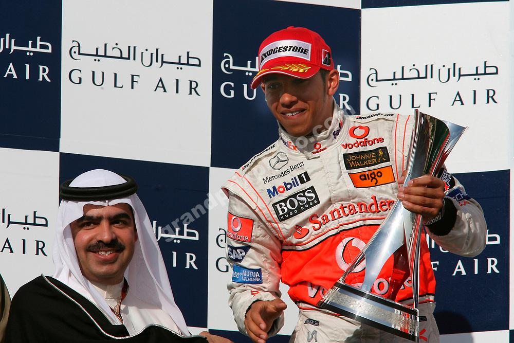 Lewis Hamilton (McLaren-Mercedes) gets his trophy on the podium after the 2007 Bahrain Grand Prix. Photo: Grand Prix Photo