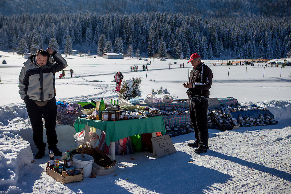 """Former refugee Elvis Causevic (left) with his father Nedzib who is collecting herbs, producing and selling teas (""""Planinski Caj"""" - Mountain Tea) and mixtures as medicine for different health problems made with recipes from his grandfather selling at Igman which is a mountain plateau in central Bosnia and Herzegovina. During the 1984 Winter Olympics, Igman was, along with Jahorina and Bjelašnica, the location of the competition in the alpine and Nordic sports disciplines. Nowadys many locals and tourists are visiting the area."""