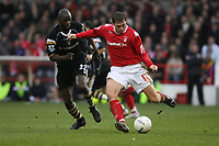 Photo: Pete Lorence.<br />Nottingham Forest v Charlton Athletic. The FA Cup. 06/01/2007.<br />Grany Holt sends the ball past Djimi Traore.