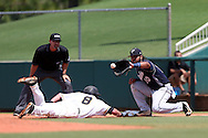 03 June 2016: Millersville's Tyler Orris (8) beats a pick-off tag by Nova Southeastern's Andres Visbal (10) to first base. The Nova Southeastern University Sharks played the Millersville University Marauders in Game 13 of the 2016 NCAA Division II College World Series  at Coleman Field at the USA Baseball National Training Complex in Cary, North Carolina. Nova Southeastern won the first game of the best of three Championship Series 2-1.