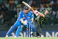 © Licensed to London News Pictures. 28/09/2012. David Warner batting during the T20 Cricket World cup match between Australia Vs India at the R.Premadasa Cricket Stadium,Colombo. Photo credit : Asanka Brendon Ratnayake/LNP