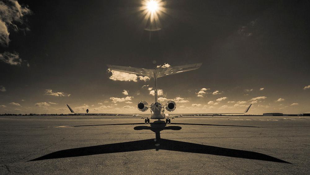 Shadow underneath a Bombardier Global Express jet at Kalamazoo International Airport in Kalamazoo, Michigan.