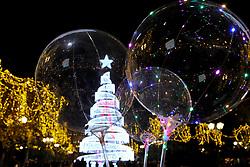 December 18, 2018 - Athens, Greece - People walk around an illuminated Christmas tree at Syntagma square in Athens. (Credit Image: © Aristidis VafeiadakisZUMA Wire)