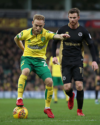 Norwich City's Alex Pritchard (left) in action with Millwall's Ryan Tunnicliffe