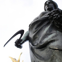 United Kingdom, Great Britain; England; London. Ann odd perspective of two statues in London.