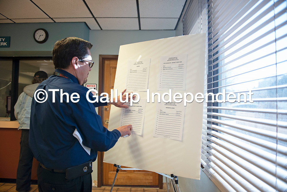 City Clerk Alfred Abeita updates this board with names and times of filings for municipal officer elections on candidate filing day Tuesday, Jan. 7 in Gallup.