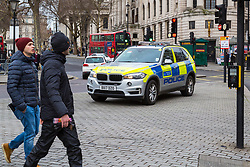 London, December 31 2017. Police in high visibility jackets and numerous anti-terrorism and crowd control measures are in place in the capital ahead of the New Year's Eve fireworks and revelry in central London. PICTURED: A police vehicle with armed officers is parked up on a traffic island in Trafalgar Square. © SWNS
