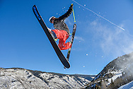Zak Fishkin launches into the air off a rock on Norway on Aspen Mountain.