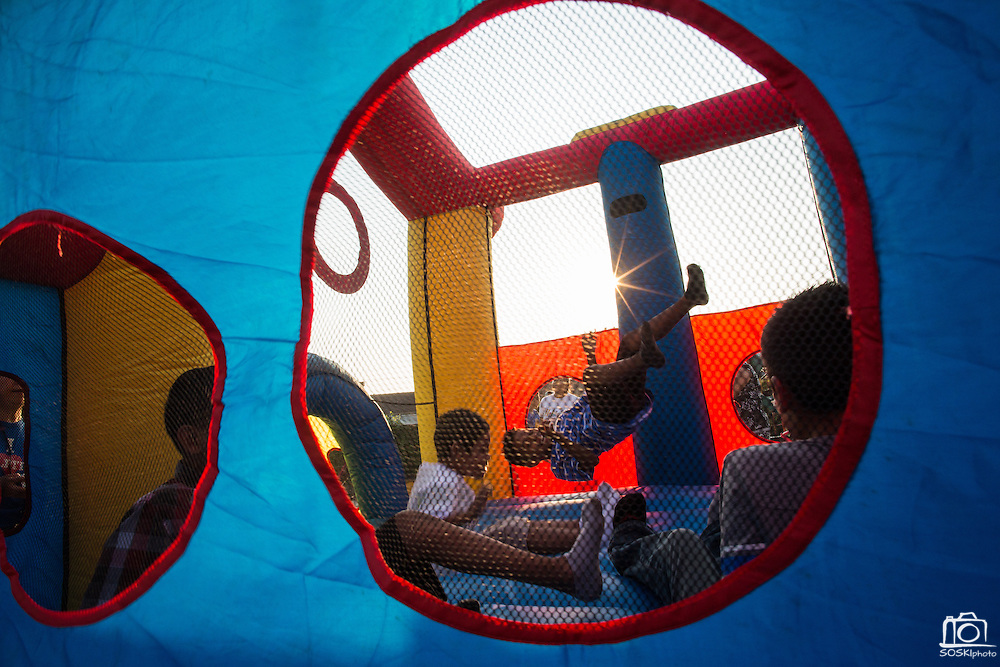 Children play in a bounce house during the National Night Out event hosted by Cathedral of Faith Milpitas at Selwyn Park in Milpitas, California, on August 7, 2014. (Stan Olszewski/SOSKIphoto)