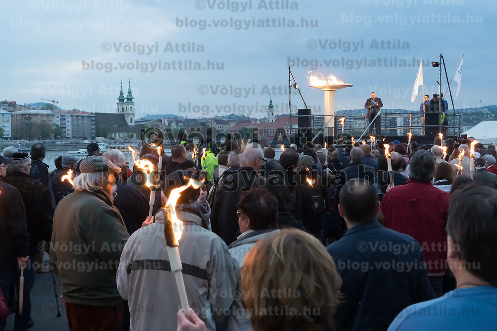Temporary flame is seen lit by Agnes Keleti five times Hungarian Olympic champion gymnast and Holocaust survivor after the March of the Living commemorating the events of the Holocaust in downtown Budapest, Hungary on April 14, 2019. ATTILA VOLGYI