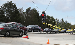 A traffic light hang loosely along Sunrise Boulevard in Plantation, FL, USA a day after Hurricane Irma knocked out power affecting 1.6 million people in Florida. Photo by Carline Jean/Sun Sentinel/TNS/ABACAPRESS.COM