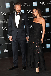 © Licensed to London News Pictures. FILE PICTURE. David Beckham, Victoria Beckham, Alexander McQueen: Savage Beauty Fashion Gala, Victoria & Albert Museum, London UK, 12 March 2015. Bookmakers have suspended bets on the Beckham's getting a divorce.  Photo credit: Richard Goldschmidt/LNP