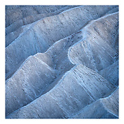 Silvery blue hues on the Zabriskie badlands after twilight, Death Valley National Park, California