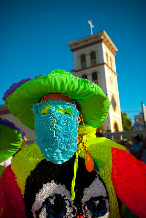 """2008-12-28-Hatillo, Puerto Rico-Hatillo Mask Festival (Festival de Mascaras de Hatillo) has its origin inspired on the biblical story when King Herod order the killing of the children.  The festival is held every year on the Day of the Innocents.  Groups of men and women dress in colorful costumes and ride around the countryside during the day, gathering at the town plaza in the afternoon, where a group of judges selects the best """"comparsa""""."""