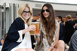 Left to right, ALICE EVE and LUPE ROLDAN at the Audi International Polo at Guards Polo Windsor Great Park, Egham, Surrey on 28th July 2013.