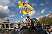 Freedom for Ocalan flags from the Trafalgar Square lions during May Day celebrations in London, England, United Kingdom. Demonstration by unions and other organisations of workers to mark the annual May Day or Labour Day. Groups from all nationalities from around the World, living in London gathered to march to a rally in central London to mark the global workers day. Abdullah Ocalan is a Kurdish nationalist leader and one of the founding members of the militant Kurdistan Workers Party or PKK. Ocalan was arrested in 1999 by the Turkish National Intelligence Agency and sentenced to death.