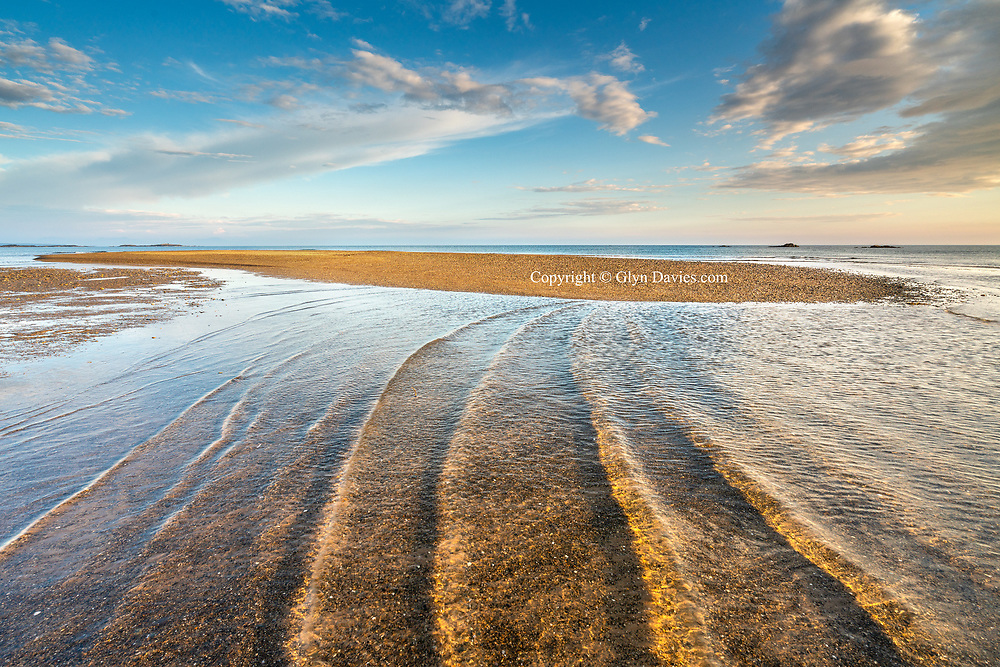 Absolutely beautiful conditions last night on the West coast of Anglesey where I did a long beach walk.  The weather over Menai was thunder and rain, but this was just at the edge of the weather front where low evening sunlight bathed the beach. On the outgoing tide the most perfect tiny waves pulsed towards the sand banks, backlit by the sunlight. It was like viewing a gigantic ripple tank experiment. The sun didn't remain intense for long and turned to one of those hazy evening where sun disappeared behind a huge cloud bank, but it remained serene anyway and held a beauty of its own.