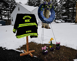 "A coat and floral wreath are displayed outside the Dewberry Street EMS Station. A funeral service and procession is held for longtime Bethlehem Emergency Medical Service employee William ""Billy"" Guth Jr. on March 21, 2015, in Bethlehem. (Chris Post 