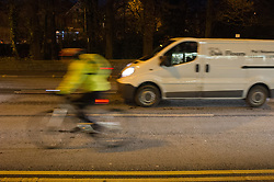 Cyclist commuting to work using a bus lane