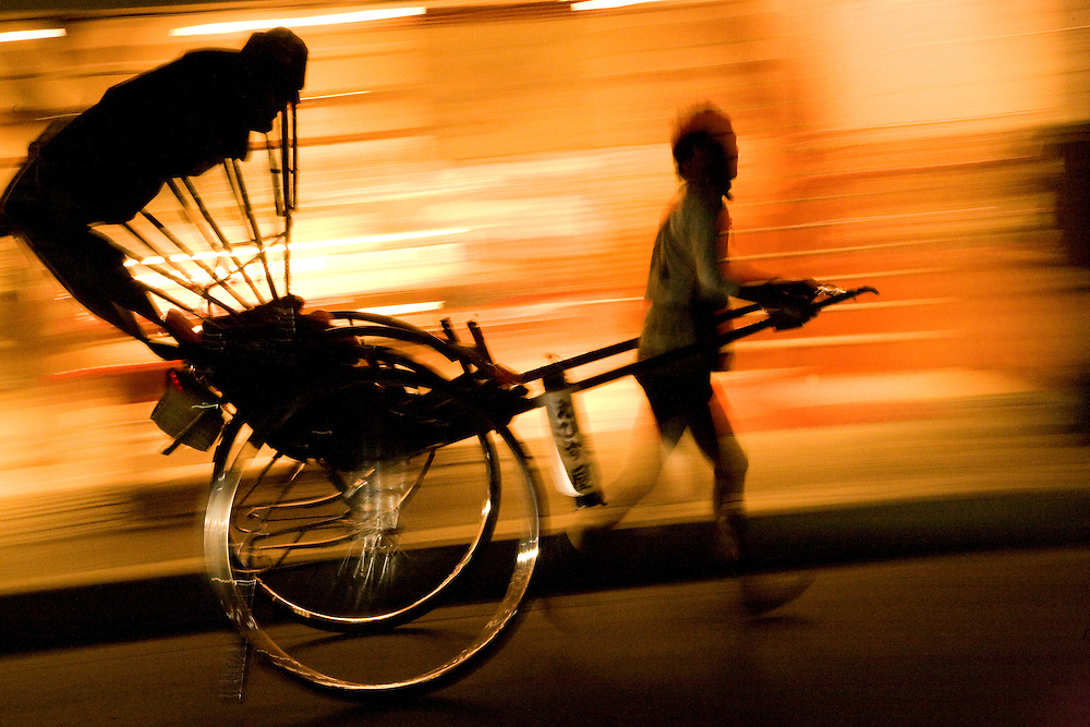 Asia, Japan, Honshu island, Kyoto, Arashiyama district, rickshaw in motion at night