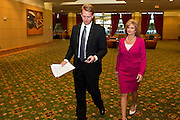 14 FEBRUARY 2011 - PHOENIX, AZ: US Congressman JEFF FLAKE (center) and his wife CHERYL FLAKE walks into a press conference to announces that he is running for the US Senate seat being vacated by retiring US Sen. Jon Kyl before Flake's press conference in Phoenix, Monday, Feb.14. Congressman Flake has been in the US House of Representatives since 2001. He is considered a conservative Republican but supports loosening sanctions against Cuba and some form of comprehensive immigration reform. He represents a conservative neighborhood in Mesa, AZ, a suburb of Phoenix.   Photo by Jack Kurtz