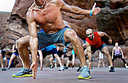 SHOT 5/25/11 6:31:10 PM - Joe Hendricks, 48, of Westminster, Co. leads an extreme workout at Red Rocks on a Wednesday evening. Hendricks leads It Burns Joe Fitness on a completely volunteer basis and usually has about 200 people showing up for the three hour long intense workouts that incorporates cardio, core work, plyometrics, yoga and more. According to Hendricks the main focus and goal of the workouts has been a better life through extreme fitness..(Photo by Marc Piscotty / © 2011)