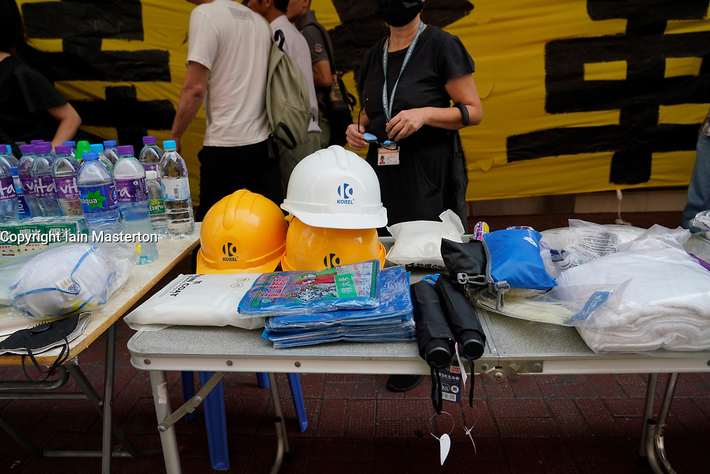 Hong Kong. 1 October 2019. Peaceful march of estimated 100,000 marchers from Causeway Bay to Central passed without trouble. Activists provoked police in the afternoon and this led to violence at various parts of the city.  Protective clothing provided for marchers. Iain Masterton/Alamy Live News.