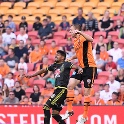 BRISBANE, AUSTRALIA - APRIL 16: Avram Papadopoulos of the Roar heads the ball over Roy Krishna of the Phoenix during the round 27 Hyundai A-League match between the Brisbane Roar and Wellington Phoenix at Suncorp Stadium on April 16, 2017 in Brisbane, Australia. (Photo by Patrick Kearney/Brisbane Roar)