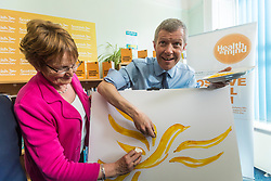 Willie Rennie visits mental health charity, Health In Mind and takes part in painting Liberal Democrat Logos before officially launching the Manifesto for the 2017 General Election.<br /> <br /> Pictured: Elizabeth Riches candidate for North East Fife and Willie Rennie