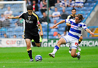 Photo: Leigh Quinnell.<br /> Queens Park Rangers v Cardiff City. Coca Cola Championship. 18/08/2007. QPRs Nick Ward launches into Cardiffs  Peter Whittingham.