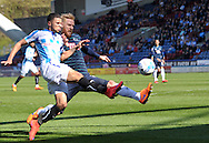 Nahki Wells of Huddersfield Town battles for the ball with Zak Whitbread of Derby County during the Sky Bet Championship match at the John Smiths Stadium, Huddersfield<br /> Picture by Graham Crowther/Focus Images Ltd +44 7763 140036<br /> 18/04/2015