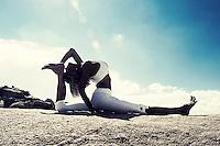 Beautiful yoga photography, earthing in the desert.