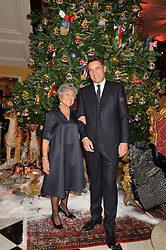 JOAN BURSTEIN and THOMAS KOCHS at a party to celebrate the unveiling of the 2014 Claridge's Christmas tree by Dolce & Gabbana at Claridge's, Brook Street, London on 19th November 2014.
