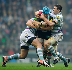Harlequins Hooker (#2) Joe Gray is tackled by London Irish Flanker (#6) Declan Danaher (capt) during the first half of the match - Photo mandatory by-line: Rogan Thomson/JMP - Tel: Mobile: 07966 386802 29/12/2012 - SPORT - RUGBY - Twickenham Stadium - London. Harlequins v London Irish - Aviva Premiership - LV= Big Game 5.