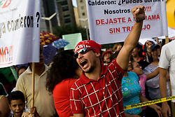 Union members and workers take part in a march to protest the closing of Luz y Fuerza, Mexico's state run power company, on Thursday, October 15, 2009.