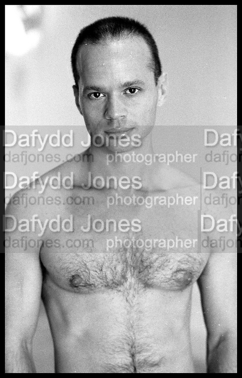 KEVIN SESSUMS in his apt in Tribeca, Manhattan. June 1989. <br />    <br /> Copyright Photograph by Dafydd Jones, 111a Wardour st. Tylers Court. London. W1F 0UJ