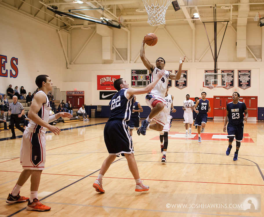 Allerik Freeman goes up and over an Impact Academy player during Findlayís nail-biting 79-78 victory.